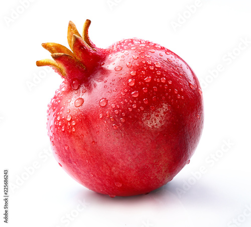 pomegranate with slice and leaf isolated white background