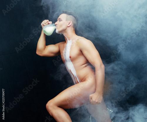 Fényképezés  man taking a bath with milk