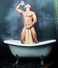 Man Taking A Bath With Milk