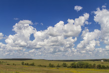 Cumulus Clouds In Blue Sky Over The Flint Hills, Tallgrass Prairie National Preserve, Kansas