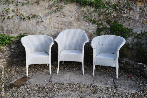 Photo  Three white Lloyd Loom chairs