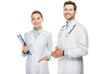 Happy Female Doctor Holding Clipboard While Her Male Colleague Standing Near Isolated On White