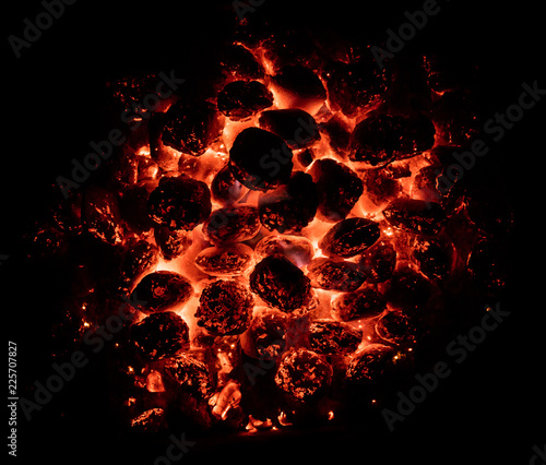 Flaming hot charcoal briquettes in detail Canvas Print