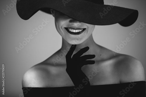 Fototapety, obrazy: Elegant beautiful woman in a black dress and hat