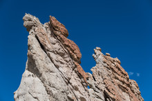 Craggy Rock Formations Against A Deep Blue Sky At Plaza Blanca, Abiquiu, New Mexico