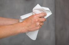 Female Hands Holding White Towel