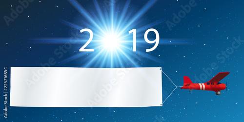 Carte de vœux 2019 montrant un avion rouge tirant une banderole blanche, devant Canvas-taulu