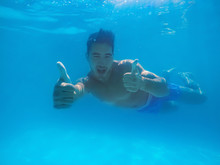 Handsome Young Man Swimming In...