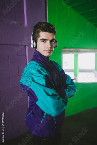 Young man in sportswear listening to music