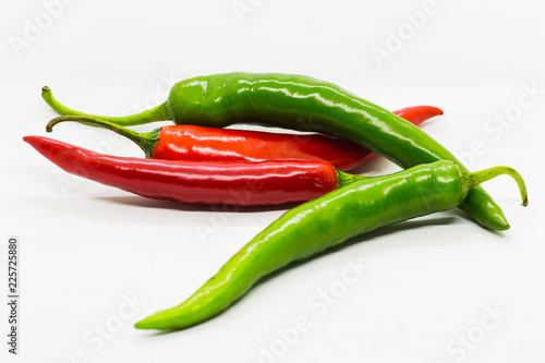 Staande foto Hot chili peppers red and green chili peppers isolated on white background