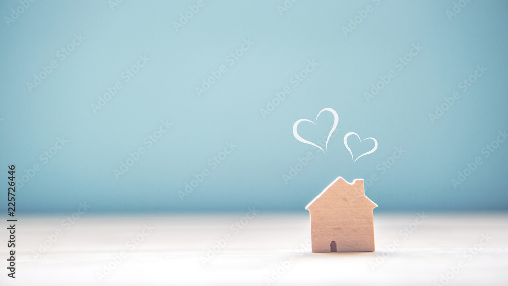 Fototapeta Home sweet home, house wood with heart shape on wooden and blue background, copy space.