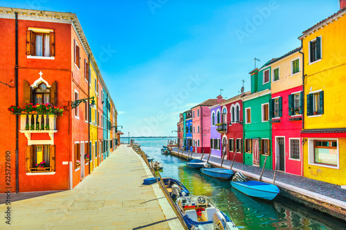 Venice landmark, Burano island canal, colorful houses and boats, Italy Canvas Print