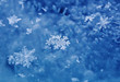 small beautiful shiny snowflakes lie on the background of cold ice
