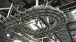 Loop of Newspapers flow along an assembly line in a newspaper factory.