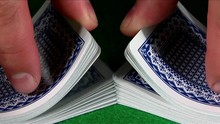 Loop Of A Deck Of Cards Is Shuffled In Slow Motion.