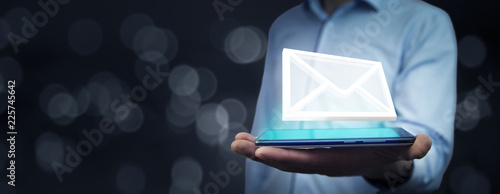 Fotografie, Obraz Businessman hand phone with email icon in screen
