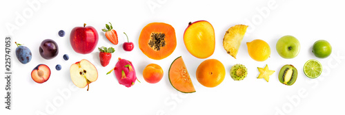 Creative layout made of fruits. Flat lay. Plum, apple, strawberry, blueberry, papaya, pineapple, lemon, orange, lime, kiwi, melon, apricot, pitaya and carambola on the white background. - 225747053