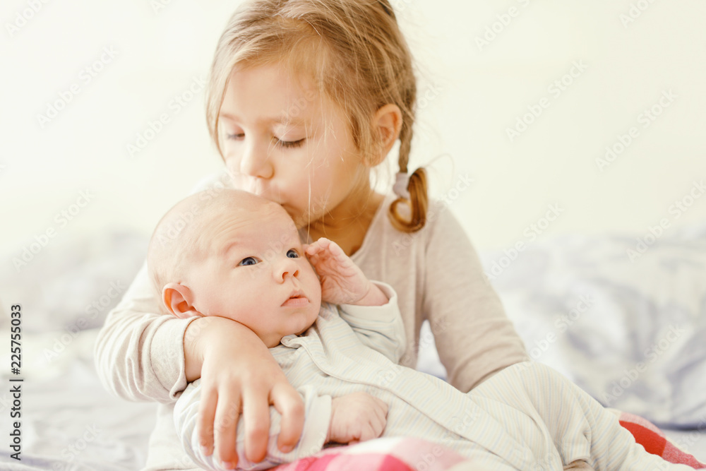 Fototapety, obrazy: sister and her newborn brother at the home