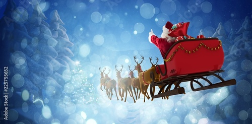 Photo  Composite image of santa claus riding on sleigh with gift box