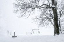 Snowstorm Over An Empty Playgr...