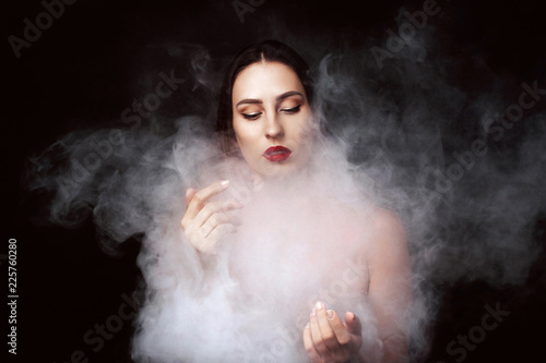 Fotografie, Obraz  Attractive young girl and white smoke.