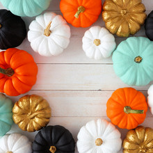 Autumn Square Frame Of Various Colorful Pumpkins On A White Wood Background. Top View With Copy Space.