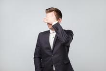 Caucasian Man In Suit Covering...