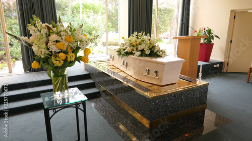 closeup shot of a funeral casket in a hearse or chapel or burial at cemetery Fototapet