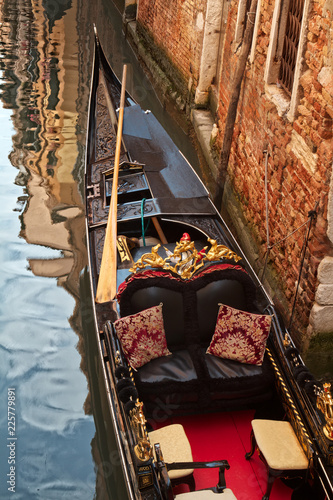 Empty gondola against a building in Venice, Italy