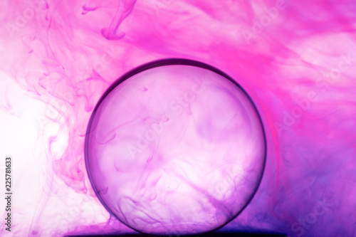 Color Ink flowing in water with Crystal ball on white background. Wallpaper Mural