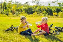 Two Little Boys Drink Water In...