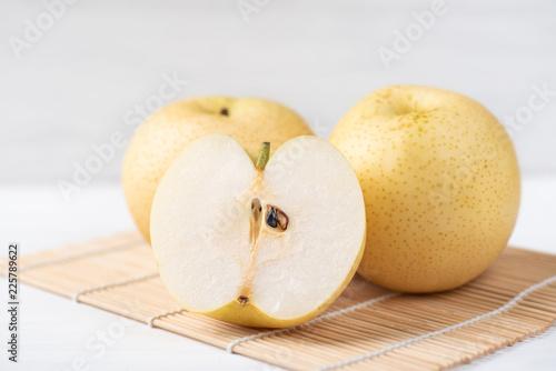 Fresh Asian pear fruit on bamboo sheet