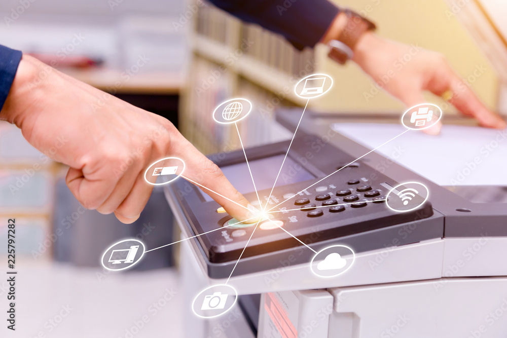 Fototapeta Bussiness man Hand press button on panel of printer with icon technology printer scanner laser office copy machine supplies start concept.