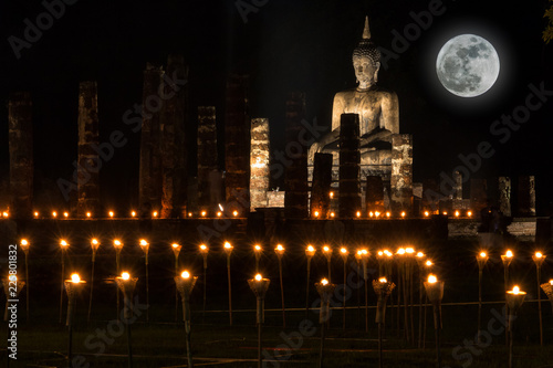 Canvas-taulu Sukhothai Co Lamplighter Loy Kratong Festival at The Sukhothai Historical Park covers the ruins of Sukhothai, in what is now Northern Thailand