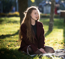 Beautiful Long-haired Girl Sit...