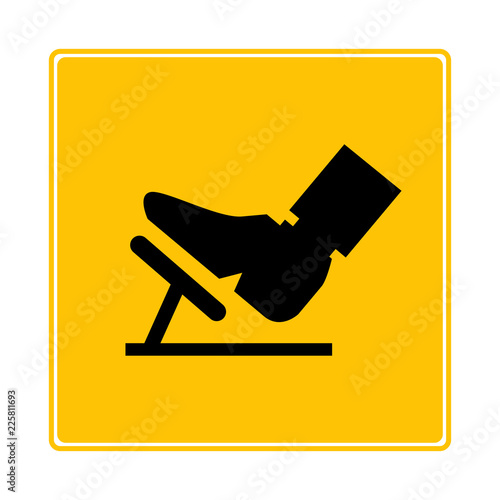 foot press accelerator pedal symbol in yellow background Fototapet