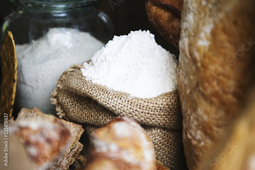 Fotobehang Aromatische Sack and a glass jar filled with white flour