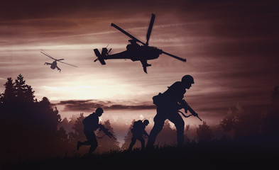 Helicopters and soldiers in...