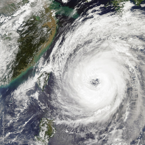 Fotobehang Onweer Typhoon Trami Takes Aim at Japan. Elements of this image furnished by NASA.