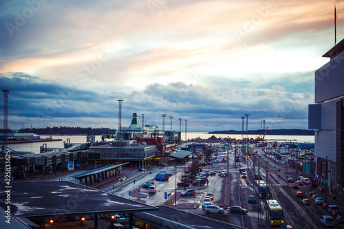 Poster de jardin Paris Panoramic view of passenger port with ships and cruise liners and huge car parking in early morning with beautiful dawn sunrise, Helsinki, Finland