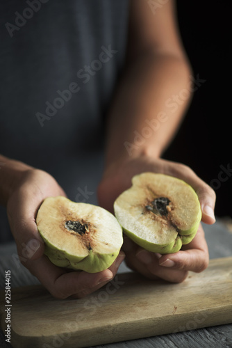 man with a quince fruit in his hands
