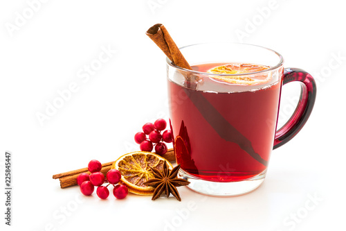 Fototapeta Hot red mulled wine isolated on white background with christmas spices, orange slice, anise and cinnamon sticks obraz