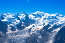 Paraglider In Front Of The Mont Blanc As Seen From Le Brevent Near Chamonix-Mont-Blanc, France