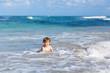 little blond kid boy having fun on ocean beach in Florida