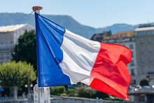 French Flag Waving Over Water ...
