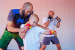 the coach teaches the boy kick Boxing