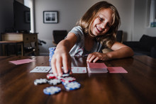 Girl Playing Cards At Table, P...