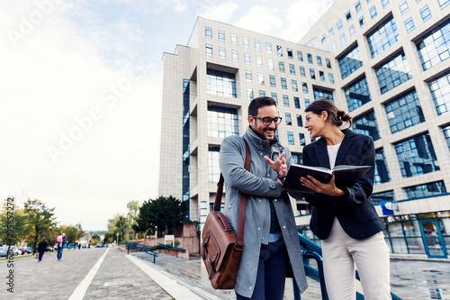 Fotografie, Obraz  Businessman and businesswoman discussing outdoor near building