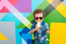 Toddler Eating Ice Cream, Mural In Background, Wynwood, Miami, Florida, USA