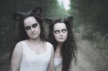 Two Twins Demons With Horns In Forest